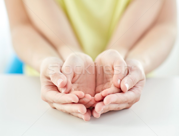 close up of woman and girl with cupped hands Stock photo © dolgachov