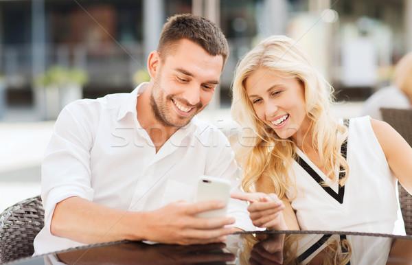 Boldog pár figyelmeztetés kávézó szeretet randevú Stock fotó © dolgachov