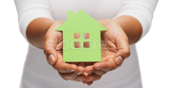 woman hands holding green house Stock photo © dolgachov