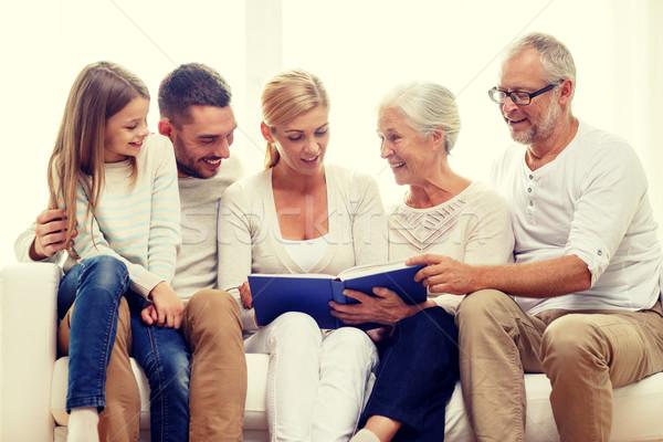 Boldog család könyv fényképalbum otthon család boldogság Stock fotó © dolgachov