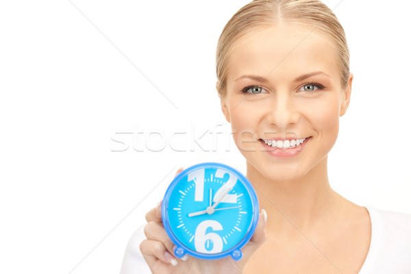 woman holding alarm clock Stock photo © dolgachov