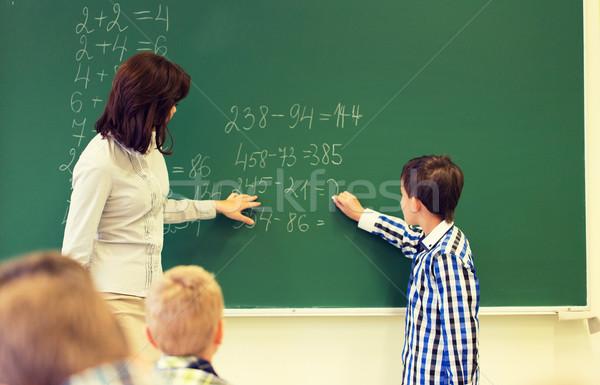 школьник Math учитель Дать мелом совета Сток-фото © dolgachov