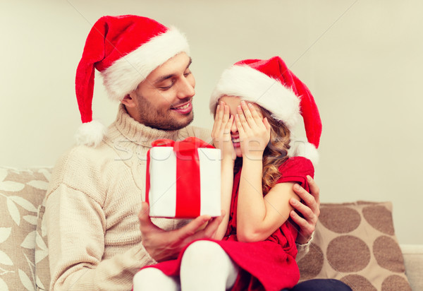 smiling daughter waiting for a present from father Stock photo © dolgachov