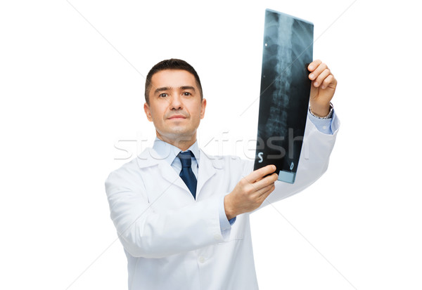 male doctor in white coat holding x-ray Stock photo © dolgachov