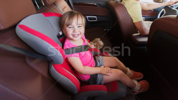 happy child sitting in car seat and father driving Stock photo © dolgachov