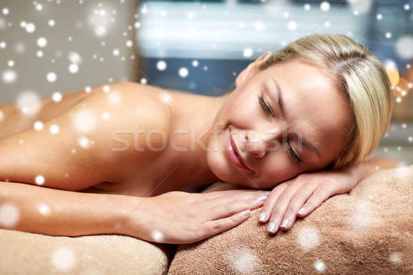 young woman lying on massage table in spa salon Stock photo © dolgachov