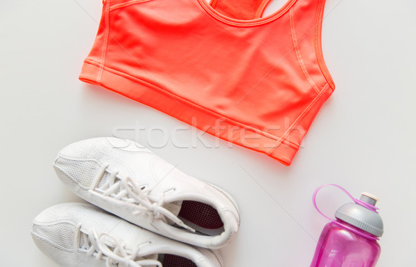 Femminile abbigliamento sportivo bottiglia set sport Foto d'archivio © dolgachov