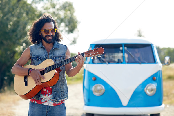 hippie man playing guitar over minivan car outdoor Stock photo © dolgachov