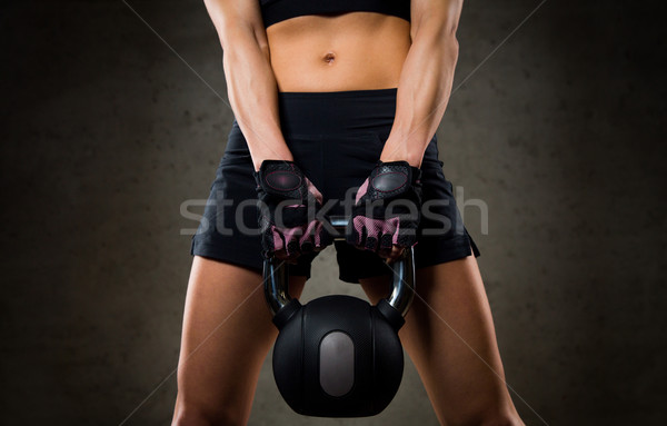 close up of woman with kettlebell in gym Stock photo © dolgachov