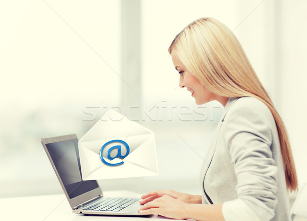 woman with laptop computer Stock photo © dolgachov
