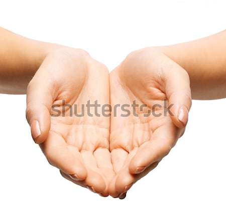 close up of womans cupped hands Stock photo © dolgachov