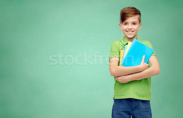 Szczęśliwy student chłopca notebooki dzieciństwo Zdjęcia stock © dolgachov