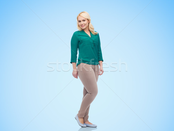 smiling young woman in shirt and trousers Stock photo © dolgachov