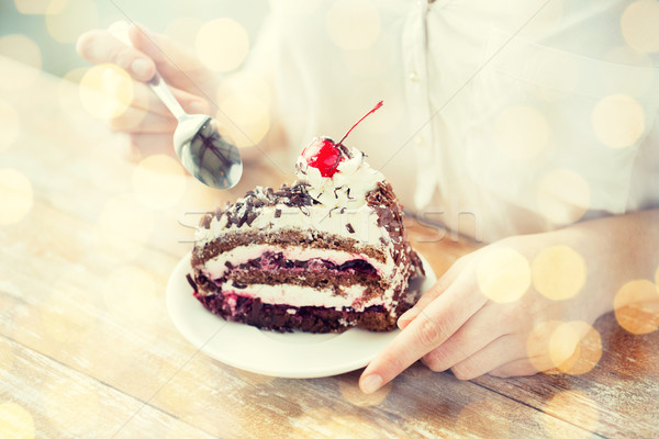 close up of woman eating chocolate cherry cake Stock photo © dolgachov