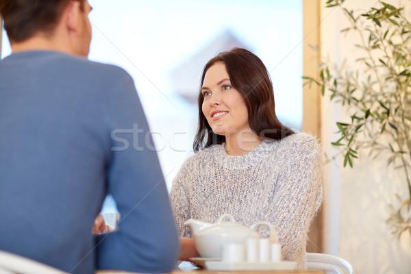 happy couple drinking tea at cafe or restaurant Stock photo © dolgachov