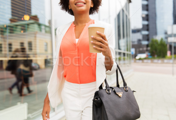 close up of african woman with coffee in city Stock photo © dolgachov