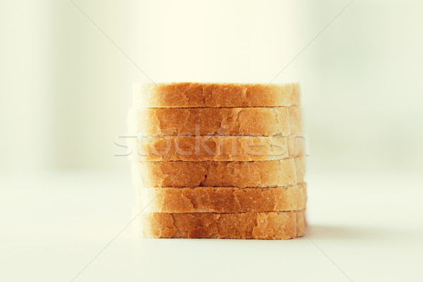 Stock photo: close up of white sliced toast bread pile on table