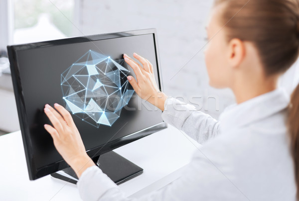 businesswoman with projection on computer Stock photo © dolgachov