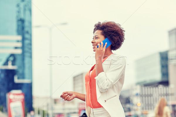 Stockfoto: Gelukkig · afrikaanse · zakenvrouw · roepen · smartphone · business