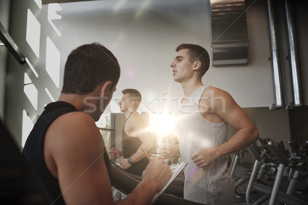 men exercising on treadmill in gym Stock photo © dolgachov