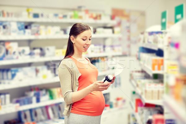 Szczęśliwy kobieta w ciąży lek apteki ciąży muzyka Zdjęcia stock © dolgachov