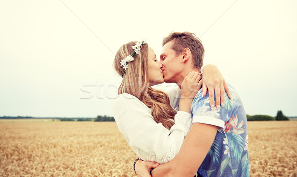 happy young hippie couple kissing in field Stock photo © dolgachov