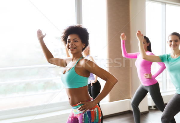 Stock photo: group of smiling woman dancing in gym or studio