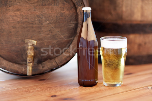 close up of old beer barrel, glass and bottle Stock photo © dolgachov