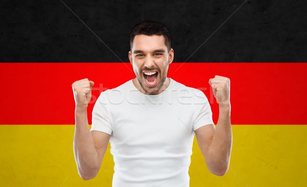 Mérges férfi mutat zászló érzelem agresszió Stock fotó © dolgachov