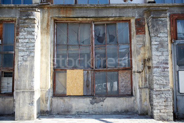 old industrial building with broken glass window Stock photo © dolgachov