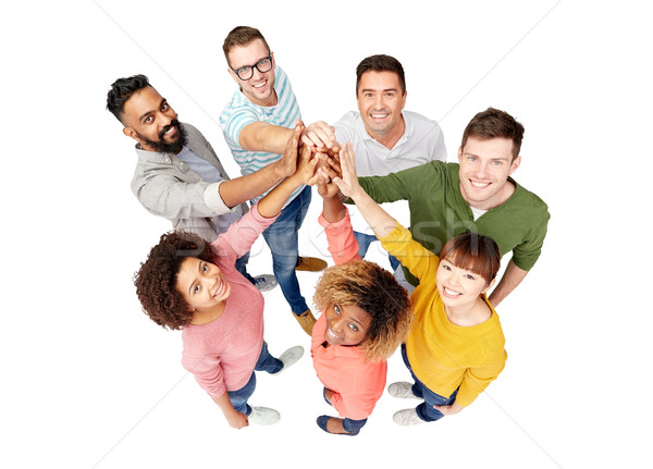 international group of people making high five Stock photo © dolgachov