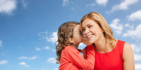 Stock photo: happy mother and girl whispering into ear