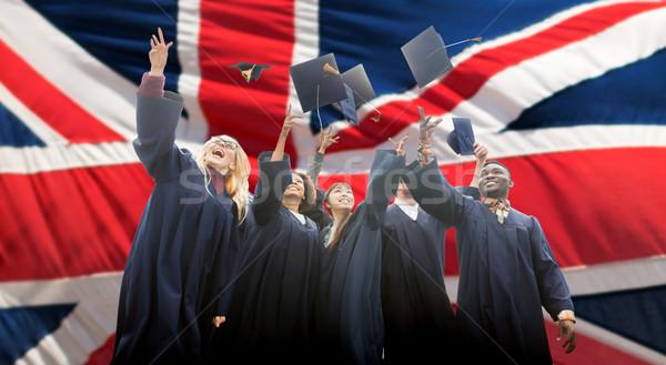 Boldog diákok dob felfelé oktatás érettségi Stock fotó © dolgachov