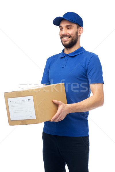 happy delivery man with parcel box Stock photo © dolgachov