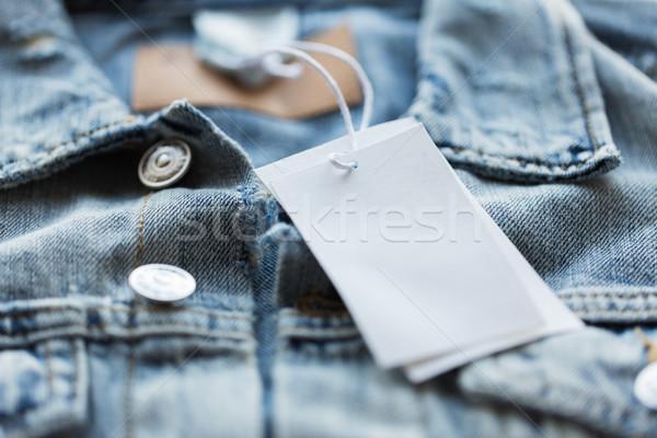 Denim jas witte prijs tag Stockfoto © dolgachov