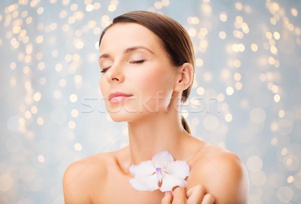 Bella orchidea fiore bellezza persone Foto d'archivio © dolgachov