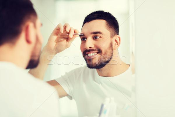 男 眉 バス 美 人 笑みを浮かべて ストックフォト © dolgachov