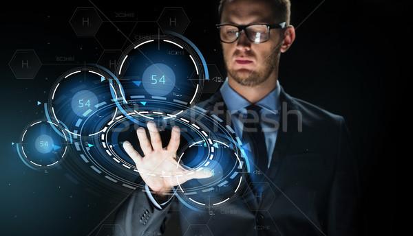 бизнесмен прикасаться виртуальный проекция деловые люди будущем Сток-фото © dolgachov