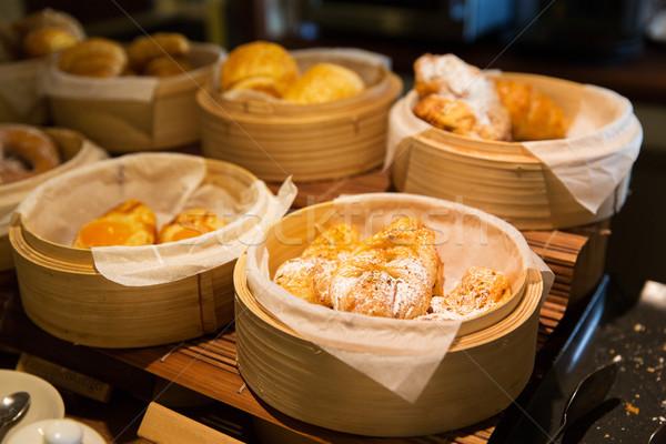 close up of buns at bakery or market Stock photo © dolgachov