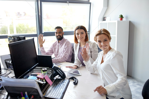 business team waving hands at office Stock photo © dolgachov