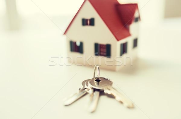 close up of home model and house keys Stock photo © dolgachov