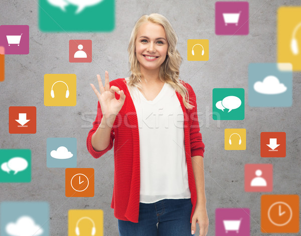 happy smiling young woman showing ok hand sign Stock photo © dolgachov