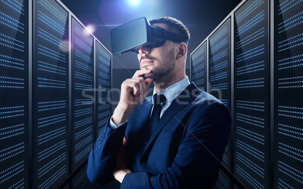 businessman in virtual reality headset Stock photo © dolgachov