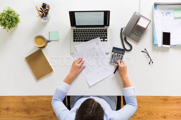 businesswoman with tax report at office Stock photo © dolgachov