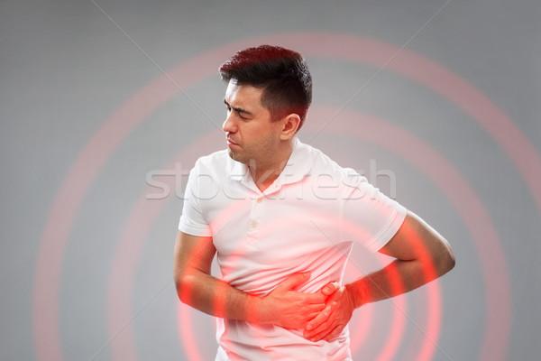 Infeliz homem sofrimento dor de estômago pessoas saúde Foto stock © dolgachov