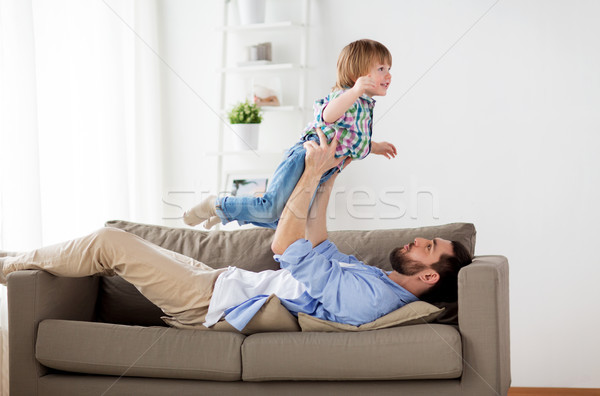 happy young father playing with little son at home Stock photo © dolgachov
