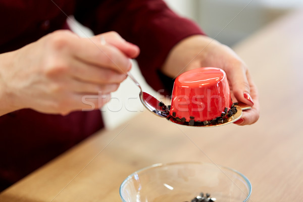 chef decorating mirror glaze cakes at pastry shop Stock photo © dolgachov