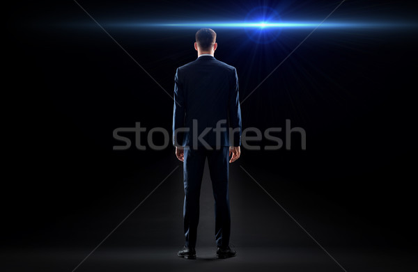 Zakenman pak Maakt een reservekopie laser licht business Stockfoto © dolgachov