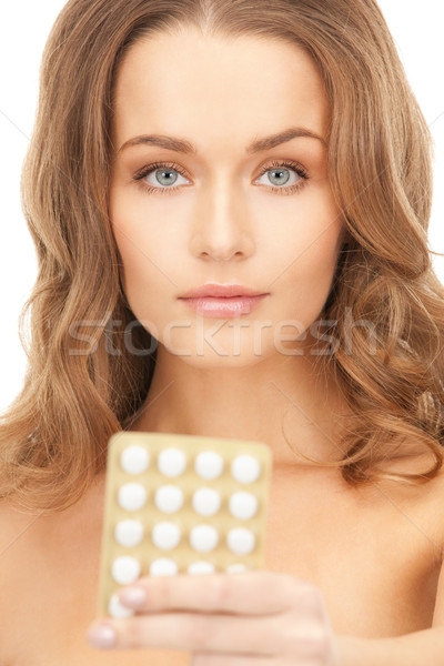 young beautiful woman with pills  Stock photo © dolgachov
