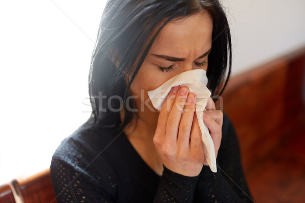 crying woman blowing nose with wipe at funeral day Stock photo © dolgachov